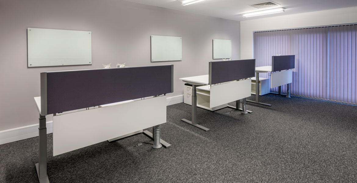 White office desking with blue desk screens