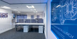 Frameless glazing system in office fit out